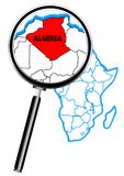Algeria Magnifying Glass. Algeria outline inset into a map of Africa over a white background viewed through a magnifying glass Stock Photo