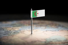 Algeria marked with a flag on the map.  royalty free stock images