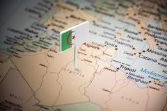 Algeria marked with a flag on the map.  royalty free stock photography