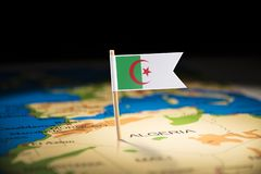 Algeria marked with a flag on the map.  stock image