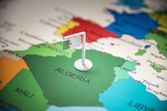 Algeria marked with a flag on the map.  royalty free stock photo