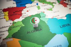 Algeria marked with a flag on the map.  stock photos