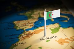 Algeria marked with a flag on the map.  royalty free stock image