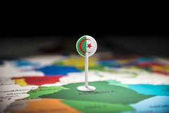 Algeria marked with a flag on the map.  stock photo