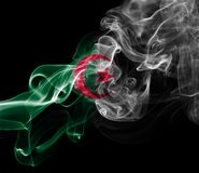 Algeria national smoke flag. Algeria smoke flag isolated on black background Stock Photos