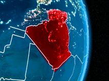 Algeria in red at night. Algeria from orbit of planet Earth at night with visible borderlines and city lights. 3D illustration. Elements of this image furnished Stock Photo