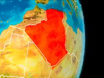 Algeria on Earth. Algeria in red on planet Earth with visible borderlines. 3D illustration. Elements of this image furnished by NASA Royalty Free Stock Photography