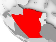 Map of Algeria in red. Algeria in red on simple grey political globe with visible country borders. 3D illustration Royalty Free Stock Photos
