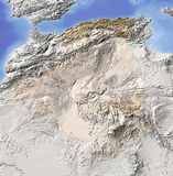 Algeria, shaded relief map. Algeria. Shaded relief map. Surrounding territory greyed out. Colored according to vegetation. Includes clip path for the state area Stock Photo