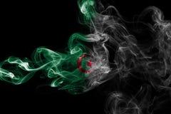 Algeria national smoke flag. Algeria smoke flag isolated on a black background royalty free stock image
