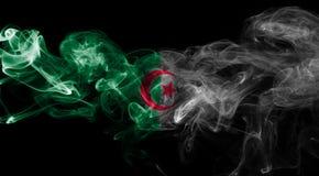 Algeria national smoke flag isolated on a black background. Algeria smoke flag isolated on a black background Stock Image