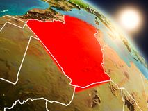 Algeria from space during sunrise. Sunset above Algeria from space on planet Earth with visible country borders. 3D illustration. Elements of this image Royalty Free Stock Images