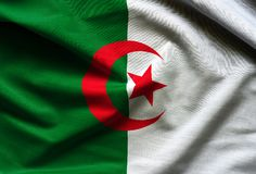 Algeria waving flag. Close up fabric background Stock Photo