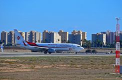 Air Algerie Plane In Front of Tower Blocks At Alicante Airport Stock Photos