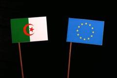 Algerian flag with European Union EU flag isolated on black. Background Stock Image