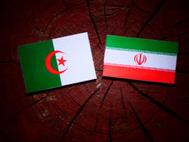 Algerian flag with Iranian flag on a tree stump isolated Stock Photo