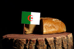 Algerian flag on a stump with bread Royalty Free Stock Photo