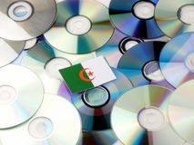 Algerian flag on top of CD and DVD pile isolated on white. Algerian flag on top of CD and DVD pile isolated Stock Photo