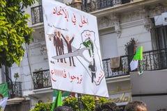 Algerians manifesting against temporary president Bensalah in Algiers, Algeria. Algerian protestant manifesting against the president Bouteflika government and stock images