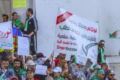Algerians manifesting against president Bouteflika regime in Algiers, Algeria. Algerian protestant manifesting against the regime and wanting a system change royalty free stock photos