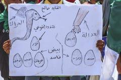 Algerians manifesting against president Bouteflika regime in Algiers, Algeria. Algerian protestant manifesting against the regime and wanting a system change stock photos