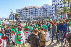 Algerians manifesting against president Bouteflika regime in Algiers, Algeria. Algerian protestant manifesting against the president Bouteflika, friday march stock photos