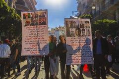 Algerians manifesting against president Bouteflika regime in Algiers, Algeria. Algerian protestant manifesting against the president Bouteflika, friday march stock image
