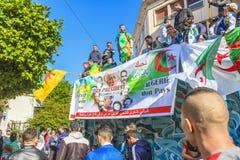 Algerians manifesting against president Bouteflika regime in Algiers, Algeria. Algerian protestant manifesting against the president Bouteflika, friday march stock photo