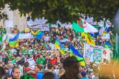 Algerians manifesting against president Bouteflika regime in Algiers, Algeria. Algerian protestant manifesting against the president Bouteflika government and stock photography