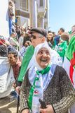 Algerians manifesting against president Bouteflika regime in Algiers, Algeria. Algerian protestant manifesting against the president Bouteflika, friday march stock images
