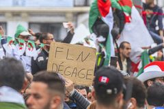 Algerians manifesting against president Bouteflika regime in Algiers, Algeria. Algerian protestant manifesting against the president Bouteflika government and royalty free stock photo