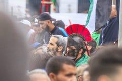 Algerians manifesting against president Bouteflika regime in Algiers, Algeria. Algerian protestant manifesting against the president Bouteflika government and royalty free stock images