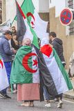 Algerians manifesting against president Bouteflika regime in Algiers, Algeria. Algerian protestant manifesting against the president Bouteflika government and royalty free stock photography