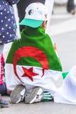 Algerians manifesting against president Bouteflika regime in Algiers, Algeria. Algerian protestant manifesting against the president Bouteflika government and royalty free stock photos