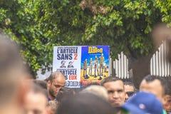 Algerians manifesting against president Bouteflika regime in Algiers, Algeria. Algerian protestant manifesting against the president Bouteflika government and stock image