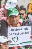 Algerians manifesting against president Bouteflika regime in Algiers, Algeria. Algerian protestant manifesting against the president Bouteflika government and stock images