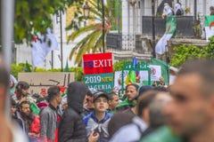Algerians manifesting against president Bouteflika regime in Algiers, Algeria. Algerian protestant manifesting against the president Bouteflika government and stock photo