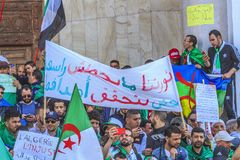Algerians manifesting against president Bouteflika regime in Algiers, Algeria. Algerian protestant manifesting against the regime and wanting a system change stock photography