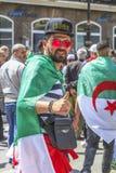 Algerians manifesting against president Bouteflika regime in Algiers, Algeria. Algerian protestant manifesting against the regime and wanting a system change royalty free stock photo