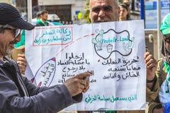 Algerians manifesting against president Bouteflika regime in Algiers, Algeria. Algerian protestant manifesting against the regime and wanting a system change stock image
