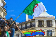 Algerians manifesting against president Bouteflika regime in Algiers, Algeria. Algerian protestant manifesting against the regime and wanting a system change royalty free stock image