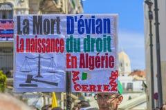 Algerians manifesting against president Bouteflika regime in Algiers, Algeria. Algerian protestant manifesting against the regime and wanting a system change stock photo