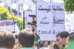 Algerians manifesting against temporary president Bensalah in Algiers, Algeria. Algerian protestant manifesting against the president Bouteflika government and royalty free stock photos