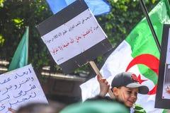 Algerians manifesting against temporary president Bensalah in Algiers, Algeria. Algerian protestant manifesting against the president Bouteflika government and stock photo