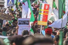 Algerians manifesting against temporary president Bensalah in Algiers, Algeria. Algerian protestant manifesting against the president Bouteflika government and stock photography