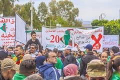Algerians manifesting against temporary president Bensalah in Algiers, Algeria. Algerian protestant manifesting against the president Bouteflika government and royalty free stock photo