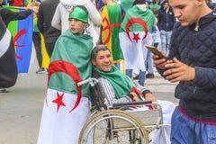 Algerians manifesting against temporary president Bensalah in Algiers, Algeria. Algerian protestant manifesting against the president Bouteflika government and royalty free stock photography