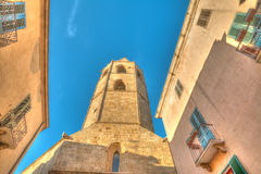 Alghero Duomo steeple under a blue sky Royalty Free Stock Photography
