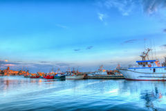 Alghero harbor under a clear sky at sunset Royalty Free Stock Photos