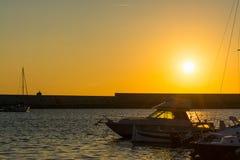 Alghero harbor under a shining sun Stock Image